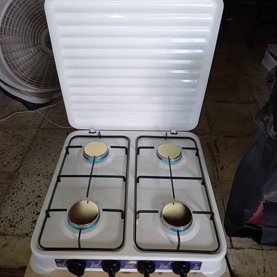 estufa a gas 4 quemadores 🔥 con tapadera sobre mesa